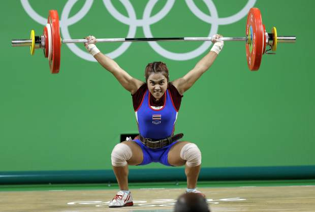 Sopita Tanasan of Thailand competes in the women's 48kg weightlifting competition at the 2016 Summer Olympics in Rio de Janeiro, Brazil. Thailand has volunteered to ban itself from Tokyo Olympic Games weightlifting next year because of doping, it was announced on Friday, dealing another blow to a sport whose place on the Olympic program is precarious.