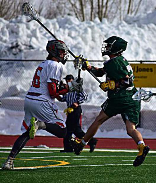 A Summit High School varsity boys lacrosse long-stick midfielder uncorks a shot attempt on net during the Tigers' 14-2 loss to the Steamboat Springs Sailors on Tuesday in Steamboat. The Tigers were within 6-2 at halftime after a strong first-half defensive performance.