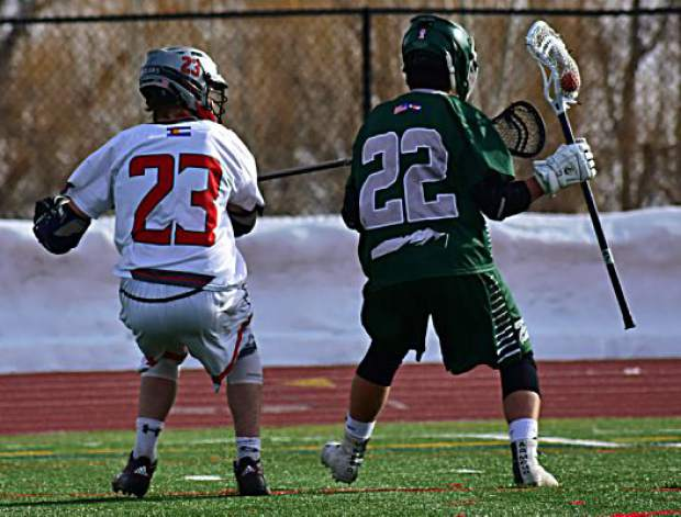 A Summit High School varsity boys lacrosse player shields possession from a defender during the Tigers' 14-2 loss to the Steamboat Springs Sailors on Tuesday in Steamboat. The Tigers were within 6-2 at halftime after a strong first-half defensive performance.
