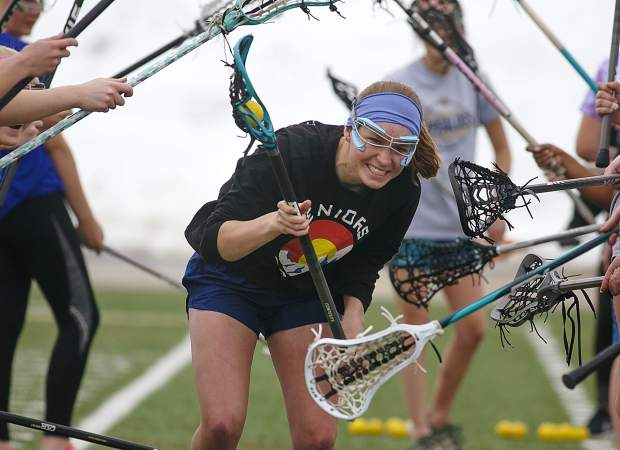 Summit High School girls lacrosse at practice Wednesday, March 27, at the Tiger Stadium near Frisco.