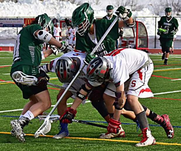 Varsity lacrosse players from Summit and Steamboat Springs high schools go after a loose ball on Tuesday during the Tigers' 14-2 loss to the Sailors in Steamboat. The Tigers were within 6-2 at halftime after a strong first-half defensive performance.