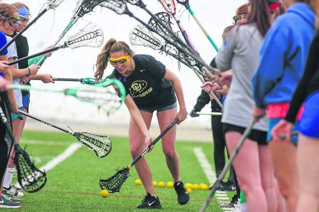 Members of the Summit High School girls lacrosse team take part in a drill on Wednesday, March 27, at Tiger Stadium near Frisco.