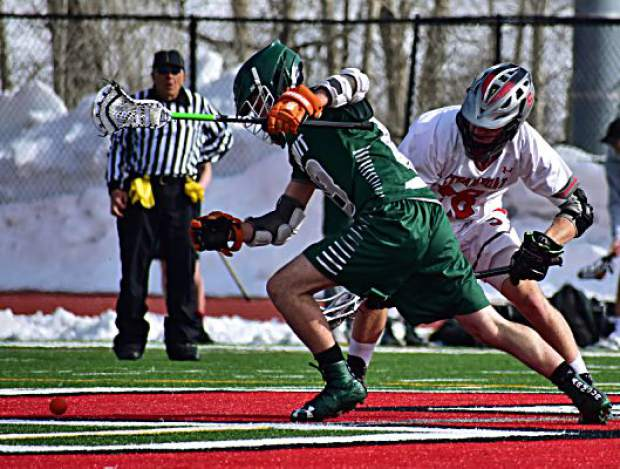 A Summit High School varsity boys lacrosse player eyes regaining possession of a loose ball after a Steamboat defender checked him during the Tigers' 14-2 loss to the Steamboat Springs Sailors on Tuesday in Steamboat. The Tigers were within 6-2 at halftime after a strong first-half defensive performance.