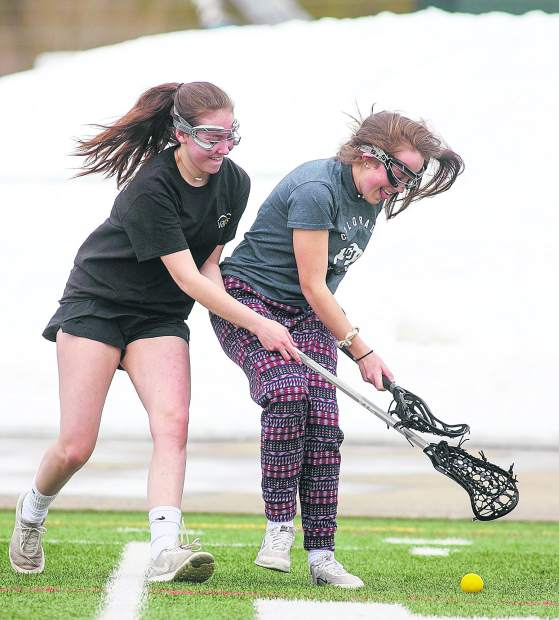 Members of the Summit High School girls lacrosse team practice on Wednesday, March 27, at Tiger Stadium near Frisco.