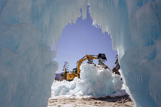 Crews work to take tear down the Ice Castles Monday, March 25, in Dillon.