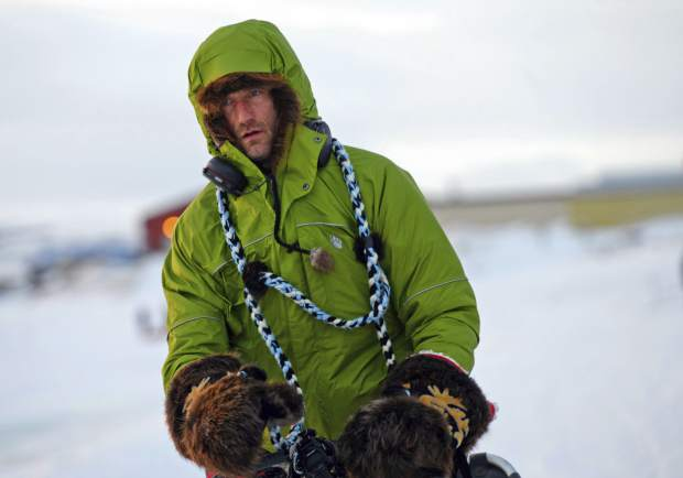 Iditarod musher Nicolas Petit arrives in Unalakleet, Alaska, on Sunday morning in the lead of the Iditarod Trail Sled Dog Race. The Frenchman, who was hours ahead in the Alaska wilderness race when his dogs refused to keep running, dismissed critics who say he ran them too hard and chalked it up to a bad memory that spooked them. It came a year after they got lost in a blizzard near the same spot along the Bering Sea coast.