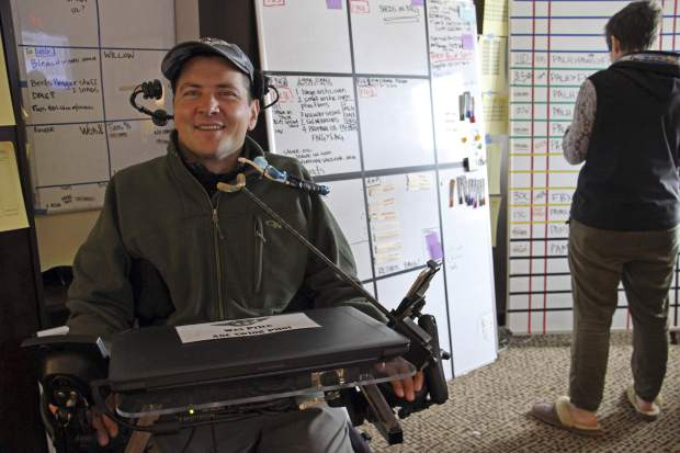 Wes Price on Tuesday explains how he helps with dispatching small aircraft flying to rural parts of Alaska as part of the Iditarod Trail Sled Dog Race from a hotel room converted into a war room in Anchorage, Alaska. The mushers' progress is monitored from several hotel rooms whose 24/7 occupants are the Iditarod's electronic eyes and ears. Price and others serve as aircraft dispatchers for a cadre of pilots who ferry supplies as well as mushers and dogs that drop out.