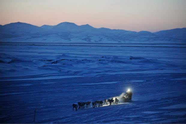 Dallas Seavey pulls in to the checkpoint in Unalakleet, Alaska, during the Iditarod Trail Sled Dog Race in March 2012. As of Friday, 51 mushers are traveling long stretches between remote village checkpoints with no other company but the dogs pulling their sleds. Their progress is monitored from several hotel rooms in Anchorage, Alaska, whose 24/7 occupants are the Iditarod's electronic eyes and ears.