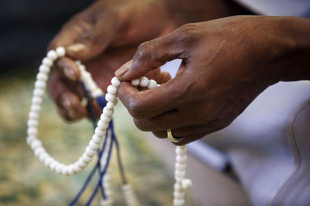 A misbaha, prayer beads, is held during the prayer for the New Zealand mosque shooting victims, during the event hosted by the Summit Colorado Interfaith Council Friday, March 22, at the Lord of the Mountains Church in Dillon. On March 15, a hate-filled terror attack targeted two mosques in the New Zealand city of Christchurch that killed at least 50 people and wounded at least 50 others.