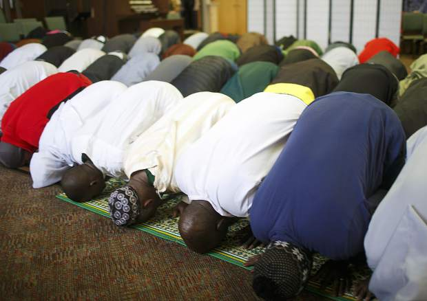Local Muslim community members bow during a prayer for the New Zealand mosque shooting victims during the event held by the Summit Colorado Interfaith Council Friday, March 22, at the Lord of the Mountains Church in Dillon. On March 15, a hate-filled terror attack targeted two mosques in the New Zealand city of Christchurch that killed at least 50 people and wounded at least 50 others.