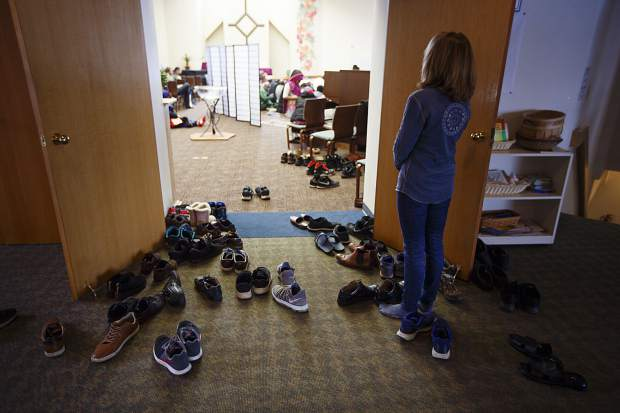 Shoes were placed outside the room during the prayer event for the New Zealand mosque shooting victims held by the Summit Colorado Interfaith Council Friday, March 22, at the Lord of the Mountains Church in Dillon.