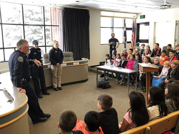 Silverthorne Police Chief John Minor, left, and other officers with the department meet with children from Dillon Valley Elementary on Friday at Silverthorne Town Hall