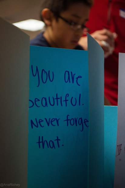 An encouraging note that's to be sent to an in-patient at the Children's Hospital Colorado is shown during last year's A Night of Goodness, an event designed to help connect people to local volunteerism opportunities.