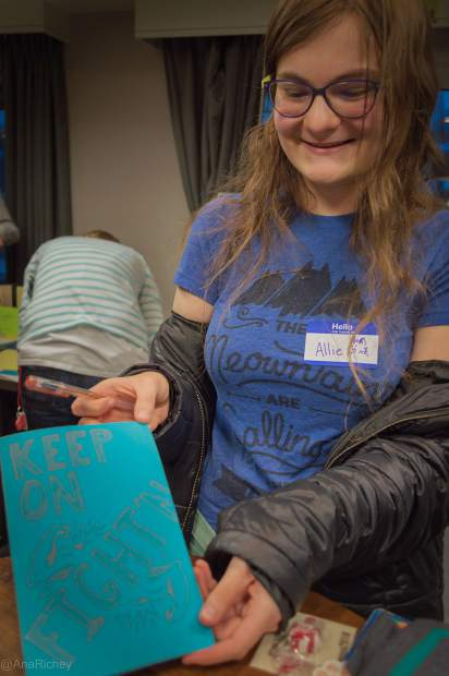 Summit County Youth student Allie Lew shows off her hand-drawn card that will bring encouragement to a child at the Children's Hospital Colorado during last yeear's A Night of Goodness at the Residence Inn by Marriot in Breckenridge.