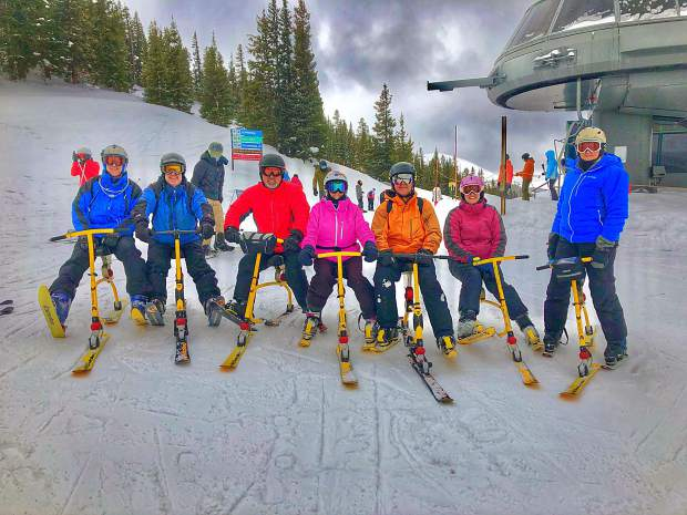 Ski bikers at the top of the Timberline Express at Copper Mountain Resort.