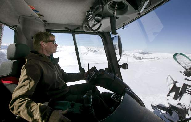 Loveland Ski Area's Ridge Cat operator and driver Bob Clawson navigates on the ridge to drop off skiers and snowboarders Friday, March 15.