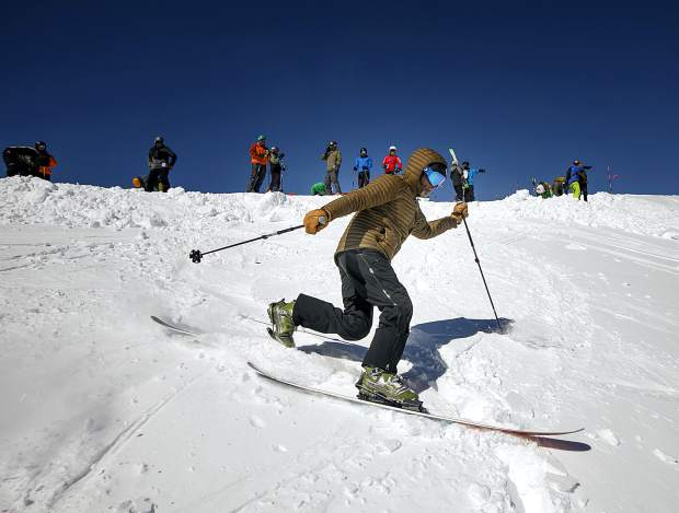 A skier descends into Field of Dreams run Friday, March 15, at Loveland Ski Area.