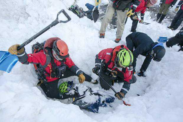 During their weekly training, members of the Summit County Rescue Group dig out a dummy victim buried beneath two meters of snow during avalanche burial scenario with multiple vehicles Wednesday, March 20, at the High Country Training Center in Frisco.