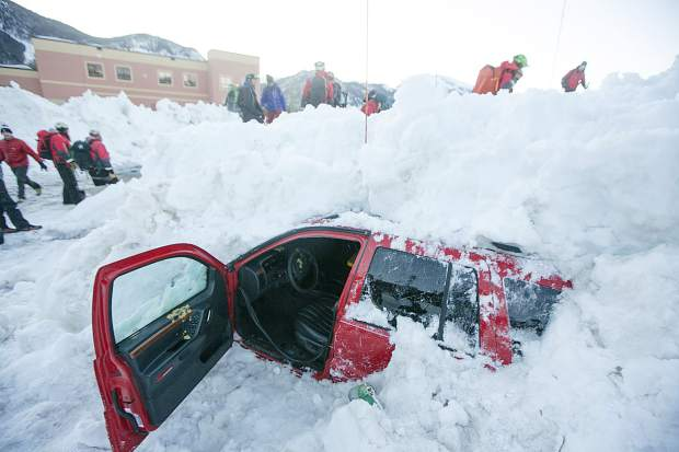 A vehicle, dug and evacuated, is seen beneath two meters of snow for the Summit County Rescue Group training scenario involving avalanche burial with multiple vehicles buried Wednesday, March 20, at the High Country Training Center in Frisco.