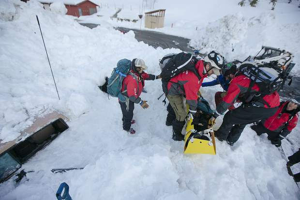 During their weekly training, members of the Summit County Rescue Group evacuate a victim on a stretcher from a buried vehicle beneath two meters of snow Wednesday, March 20, at the High Country Training Center in Frisco.