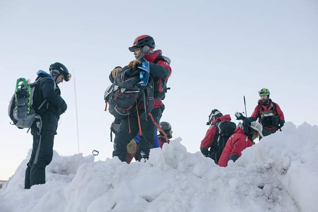During their weekly training, members of the Summit County Rescue Group conduct avalanche burial scenario with multiple vehicles buried beneath two meters of snow Wednesday, March 20, at the High Country Training Center in Frisco.