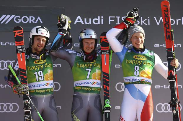 From left, second placed Norway's Rasmus Windingstad, the winner, Norway's Henrik Kristoffersen and third placed Switzerland's Marco Odermatt celebrate on podium after an Alpine Skiing World Cup men's Giant Slalom, in Kranjska Gora, Slovenia on Saturday.