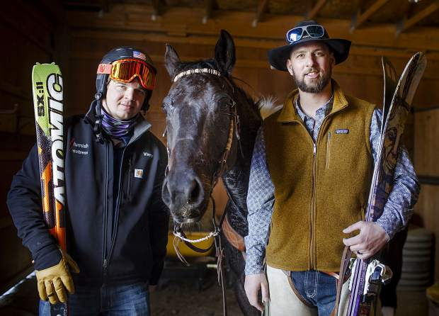 Summit County brothers Vinny (left) and AJ Pestello pose for a photograph inside a barn at Pass Creek Ranch as seen on Wednesday, Feb. 27. The brothers were at the ranch to prep for the weekend's 71st annual skijoring event in Leadville.