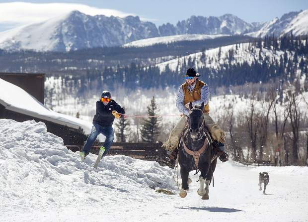 The Summit County brotherly skijoring duo of Vinny (skiing) and AJ Pestello (horseback) practice for the upcoming weekend's 71st annual skijoring event in Leadville on the jumps they built themselves at Pass Creek Ranch near Ute Pass north of Silverthorne, on Wednesday, Feb. 27.