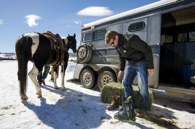 Vinny Pestello of Breckenridge prepares to don his ski boots to practice skijoring at Pass Creek Ranch near Ute Pass north of Silverthorne on Wednesday, Feb. 27.