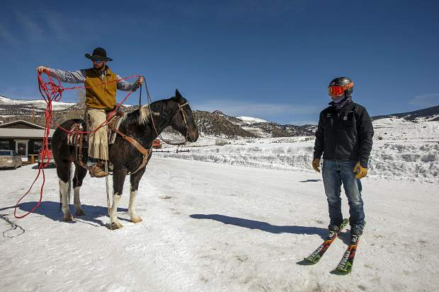 The Summit County brotherly skijoring duo of AJ, left, and Vinny Pestello gear up to practice at Pass Creek Ranch near Ute Pass north of Silverthorne on Wednesday, Feb. 27.