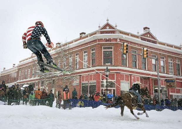 Summit County resident and skier Vinny Pestello hangs on during a run down the course at the 71st Leadville Ski Joring competition on Sunday afternoon, March 3, in Leadville.