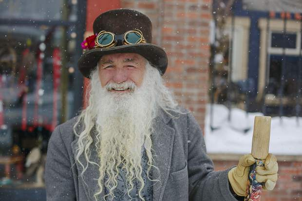 Leadville town greeter, James Duke, watches competitors on Harrison Avenue during the 71st Leadville Ski Joring competition on Sunday afternoon, March 3, in Leadville.