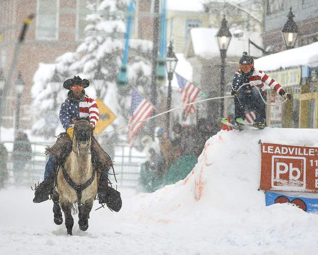 Summit County resident Al Mikkelsen on his horse pulls Vinny Pestello down the course during the 71st Leadville Ski Joring competition on Sunday afternoon, March 3, in Leadville.