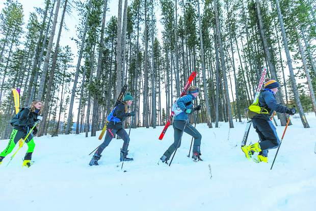 Cadet ski mountaineering athletes, ages 15-17, from left to right, Sam Wescott, , Elsa Bates, Grace Staberg, and Mark Jardim boot-pack uphill during practice on Tuesday, Dec. 11, in Breckenridge.