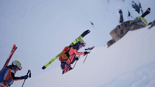 Sierra Anderson (center) ascends by boot-pack during a ski mountaineering competition at Arapahoe Basin Ski Area in December.