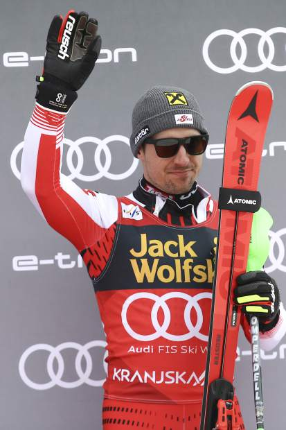 Third-place finisher Marcel Hirscher of Austria celebrates on the podium of an Alpine Skiing World Cup men's slalom event in Kranjska Gora, Slovenia on Sunday.
