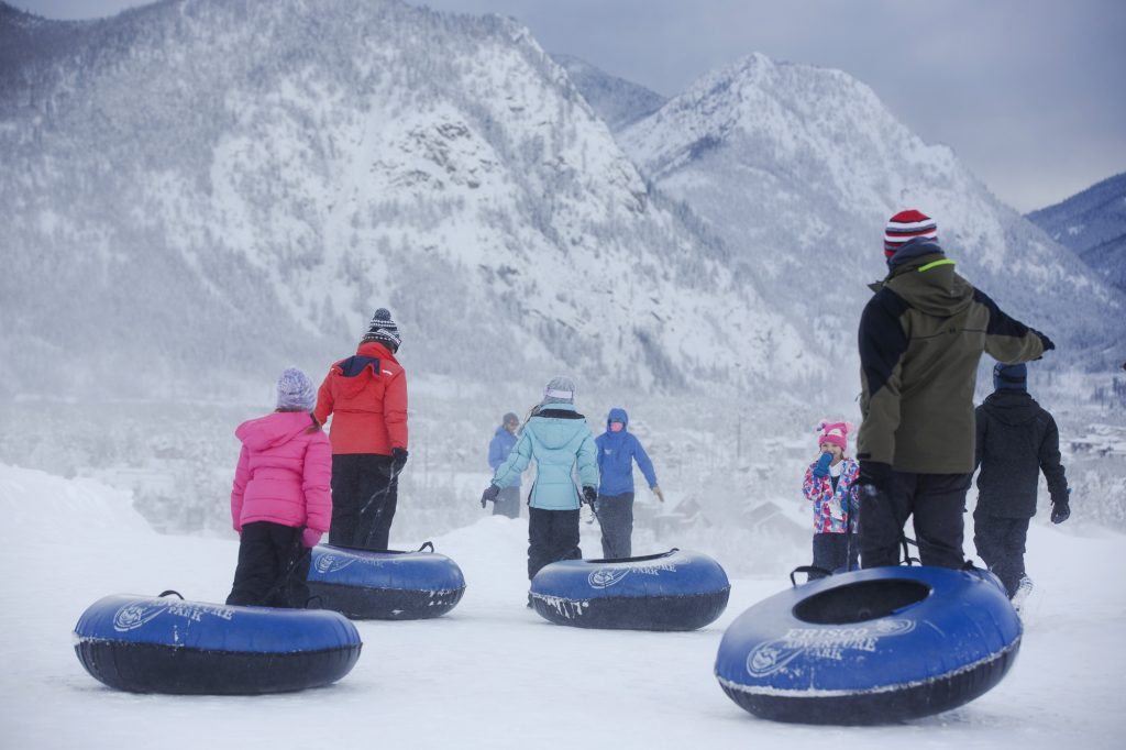 People drag their snow tubes for downhill sledding at the Frisco Adventure Park Thursday, March 7, 2019 in Frisco, Colo.