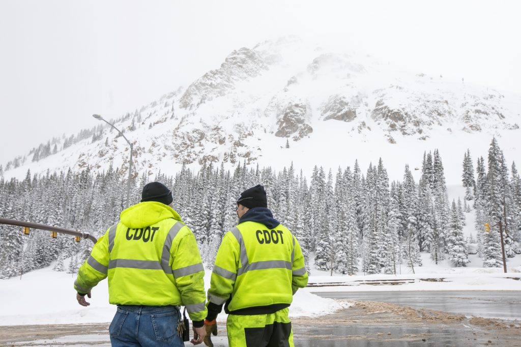CDOT officials discuss with each other near Interstate 70 during snowstorm Thursday, March 7, 2019, at Loveland Pass.