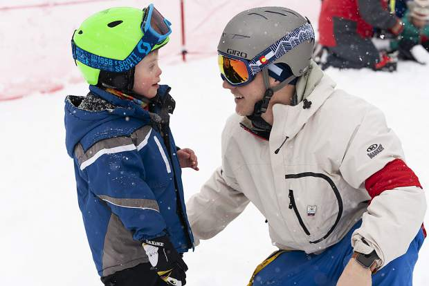 A young skier and a coach embrace during this past weekend's 2019 Special Olympics Colorado State Winter Games at Copper Mountain Resort.