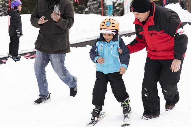 A family member films while a young skier is coached along during this past weekend's 2019 Special Olympics Colorado State Winter Games at Copper Mountain Resort.