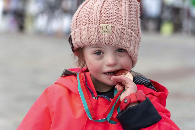 A young athlete bites her medal during this past weekend's 2019 Special Olympics Colorado State Winter Games at Copper Mountain Resort.