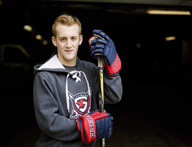 Ben Carlson, a Summit High School senior who won a club hockey national championship earlier this month with the Richmond Generals in Virginia, poses for photo on Thursday, March 21, in Frisco.