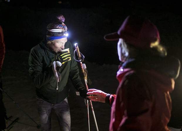 Carbondale's Sean Van Horn rehydrates before another ascent lap on Buttermilk Mountain on Sunday night, March 17, near Aspen. Van Horn was attempting to break North America's record for the most vertical gain on skis in 24 hours.