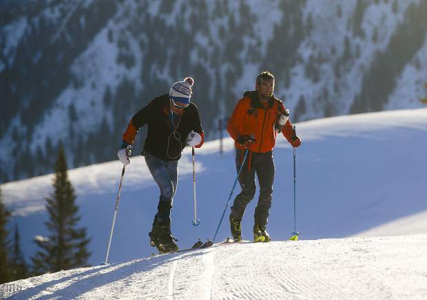 Carbondale's Sean Van Horn, left, skins uphill with Doug Stenclik, owner of the Cripple Creek Backcountry ski shop, at Buttermilk Mountain on Monday morning, March 18, near Aspen. Van Horn was attempting to break North America's record for the most vertical gain on skis in 24 hours.