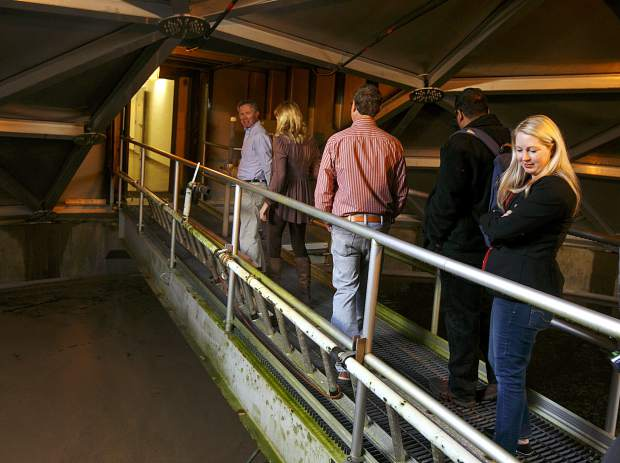 Summit County Commissioner Elisabeth Lawrence, far right, takes a look inside the water clarifier room at the Snake River Wastewater Treatment Plant Tuesday, March 26, in Dillon.