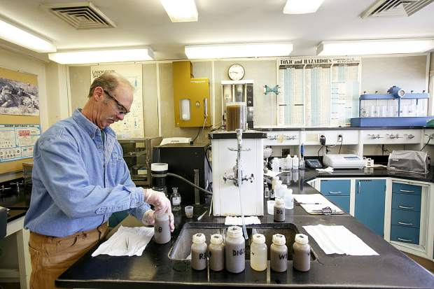 Snake River Wastewater Treatment Plant Lab Technician Kevin McCormick tests water quality in the plant's laboratory room Tuesday, March 26, in Dillon.
