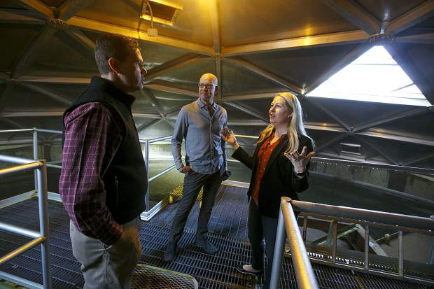 Summit County Public Works Director Tom Gosiorowski, left, speaks to Summit County commissioners Thomas Davidson, center, and Elisabeth Lawrence, right, during a tour inside the water clarifier at the Snake River Wastewater Treatment Plant Tuesday, March 26, in Dillon.