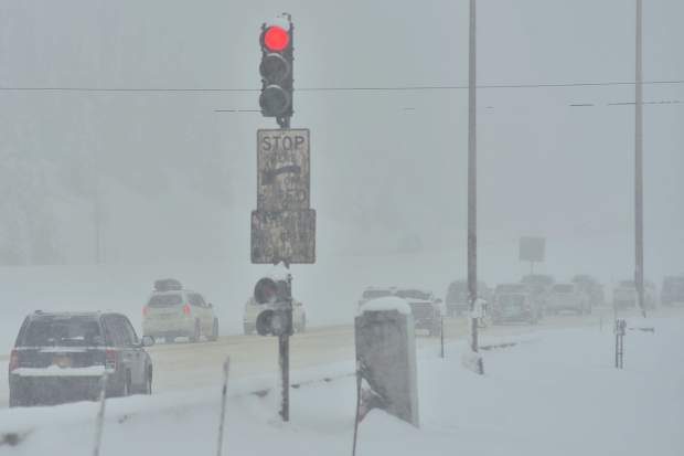 The light at an Interstate 70 onramp in Frisco releases cars onto the interstate Sunday. The interstate was closed for safety precautions, multiple spun-out vehicles and avalanches on Sunday.