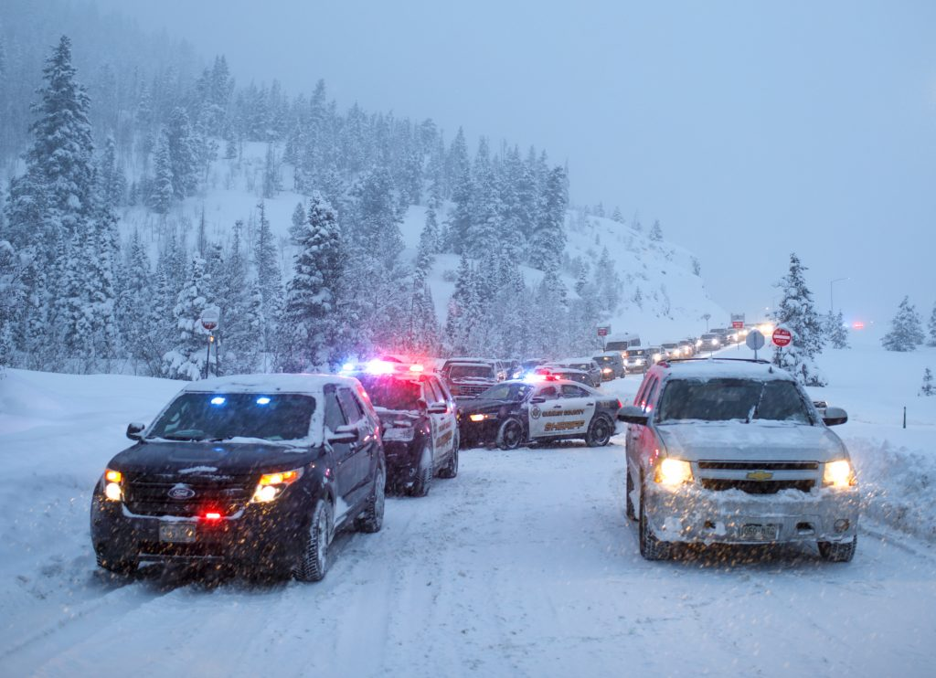 Summit County Sheriff Department deputies block Interstate 70's entrance from Frisco Sunday evening, March 3. I-70 is currently closed between Frisco and Vail.
