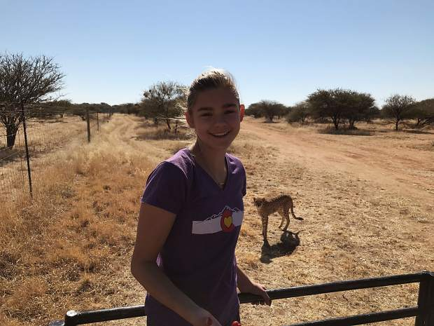 Devon Galpin, with a cheetah standing behind her, in Namibia in this undated photograph. Galpin traveled to Namibia, Patagonia and Borneo during her year abroad doing research for Endangered Activism.